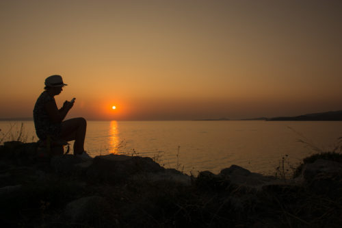 Sunset with the girl texting - free  images to use -