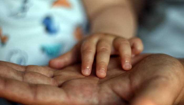 Picture of baby small and gentle touching hand