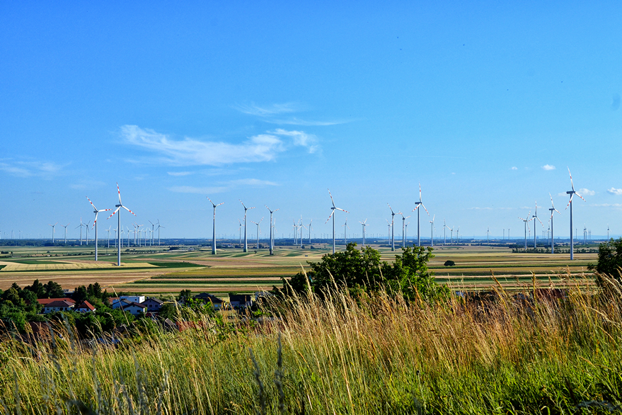 Wind turbines field next to small village