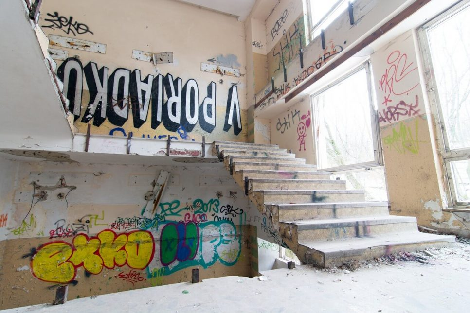 Abandoned building stairs with graffiti