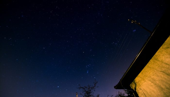 Star sky above house