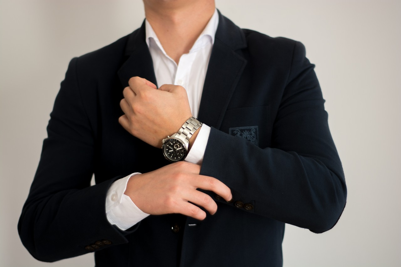 Man wearing a suit buttoning sleeve