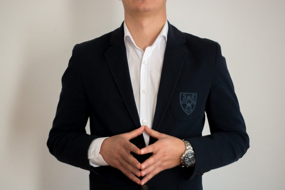 Man wearing a suit standing and waiting