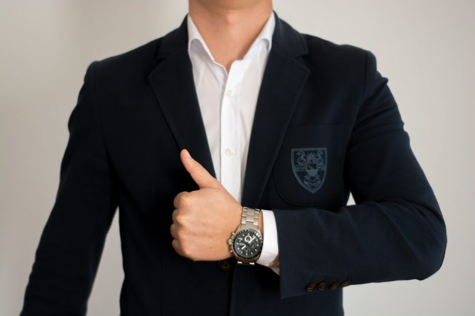Man wearing a suit thumbs up