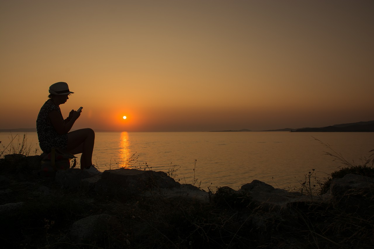 Sunset with the girl texting