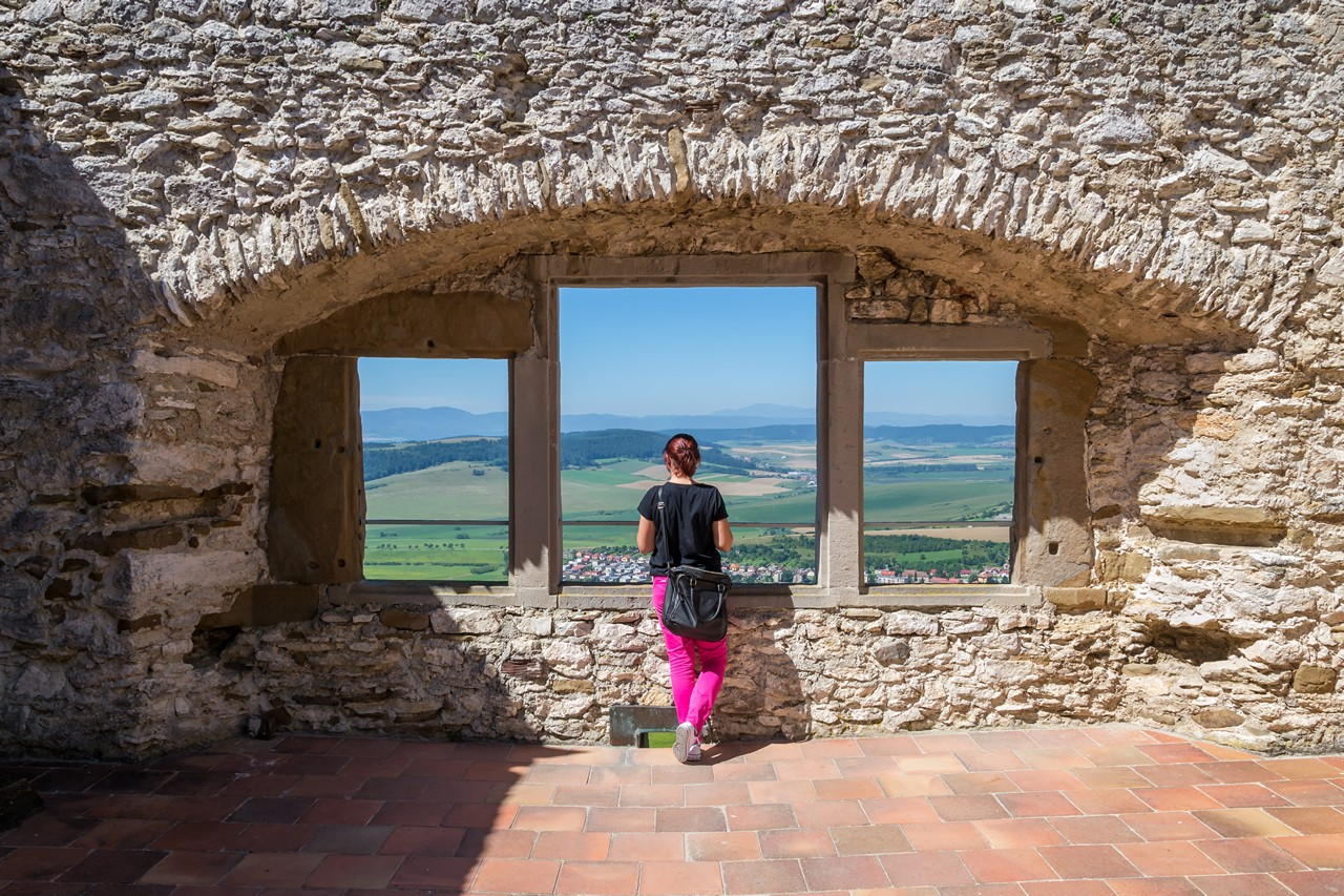 Girl enjoying a nice view from the old castle