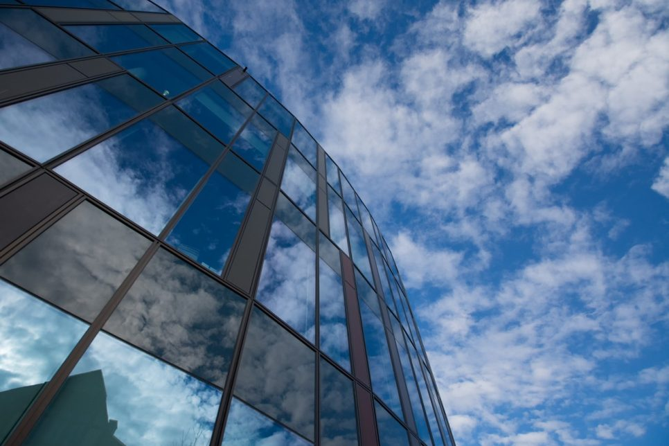 Glass building with sky reflection